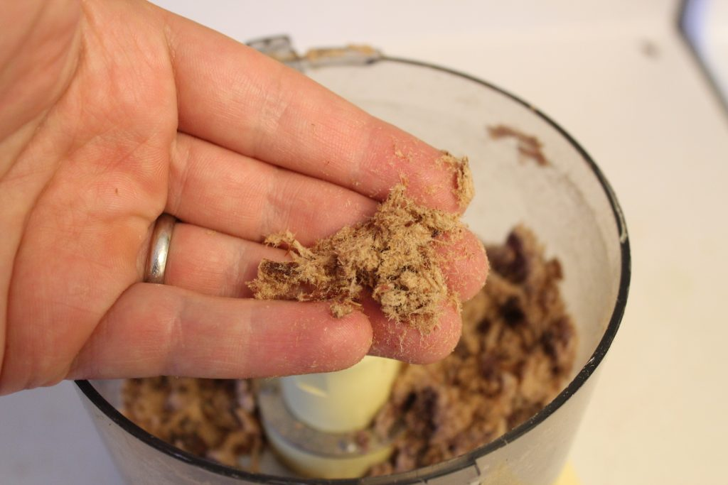 Shredding dried meat using a food processor into a floss to make pemmican