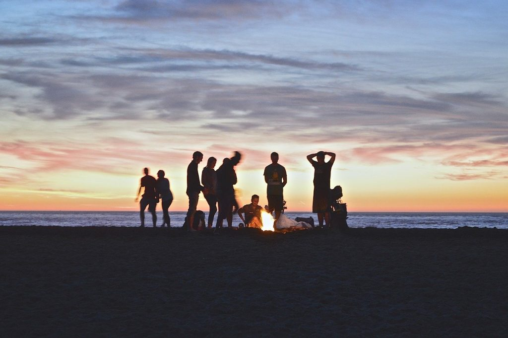 21 Campfire Games for Adults That are a Total Blast