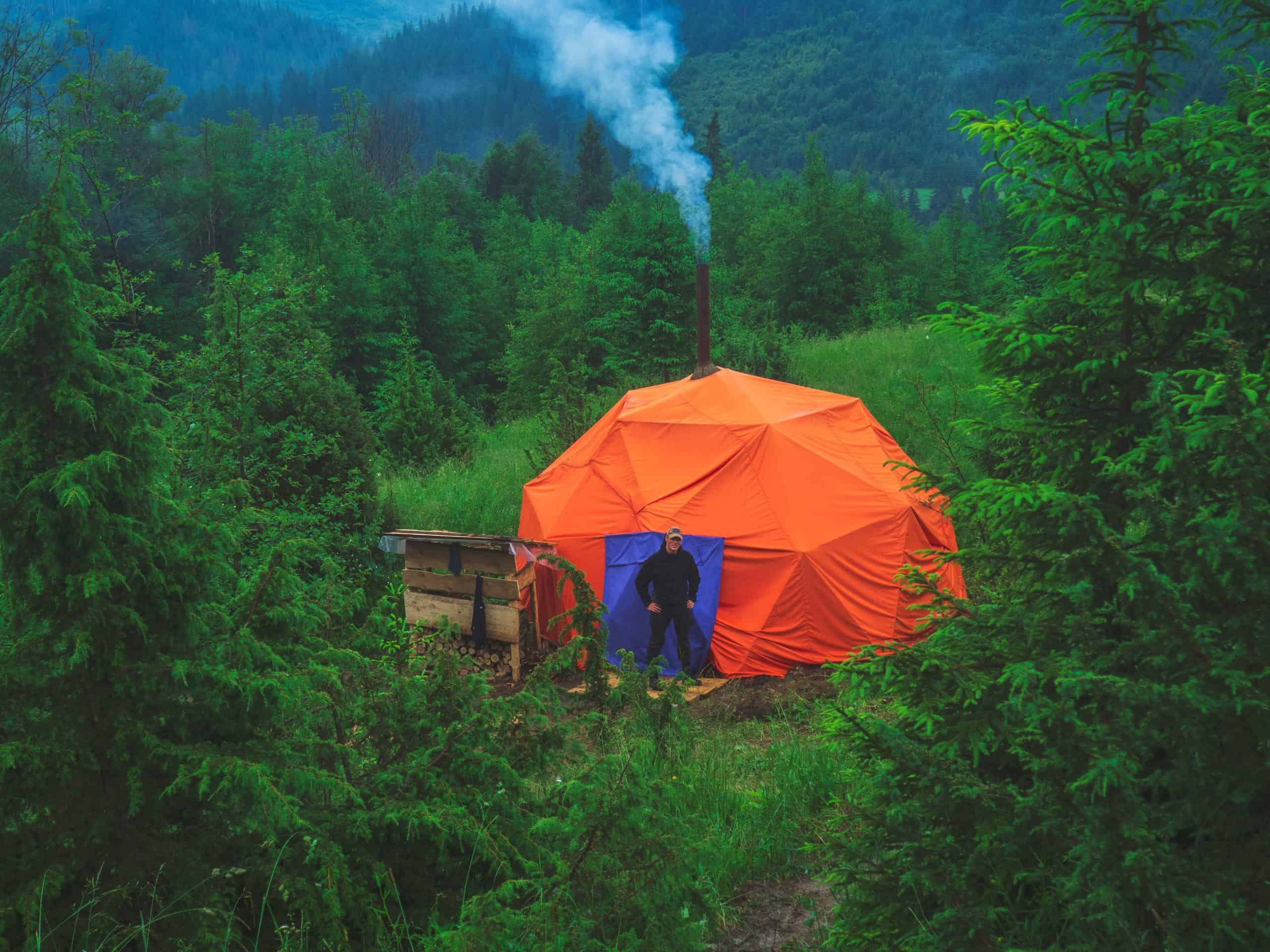 A tent with stove jack in an evergreen forest is a great way to stay warm during the winter or in cold climates.  Try hot tenting and you will want to camp in all four seasons.